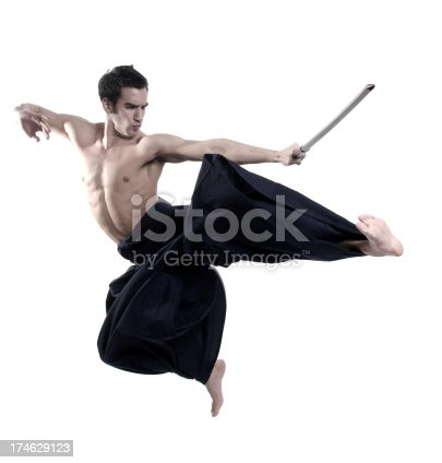istock Laido martial arts: young male with sword 174629123