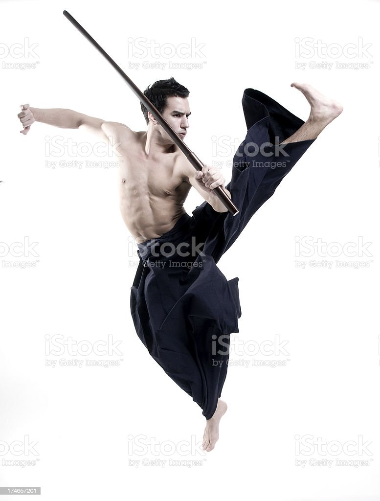 laido martial arts: young male with sword wearing kendo pants royalty-free stock photo