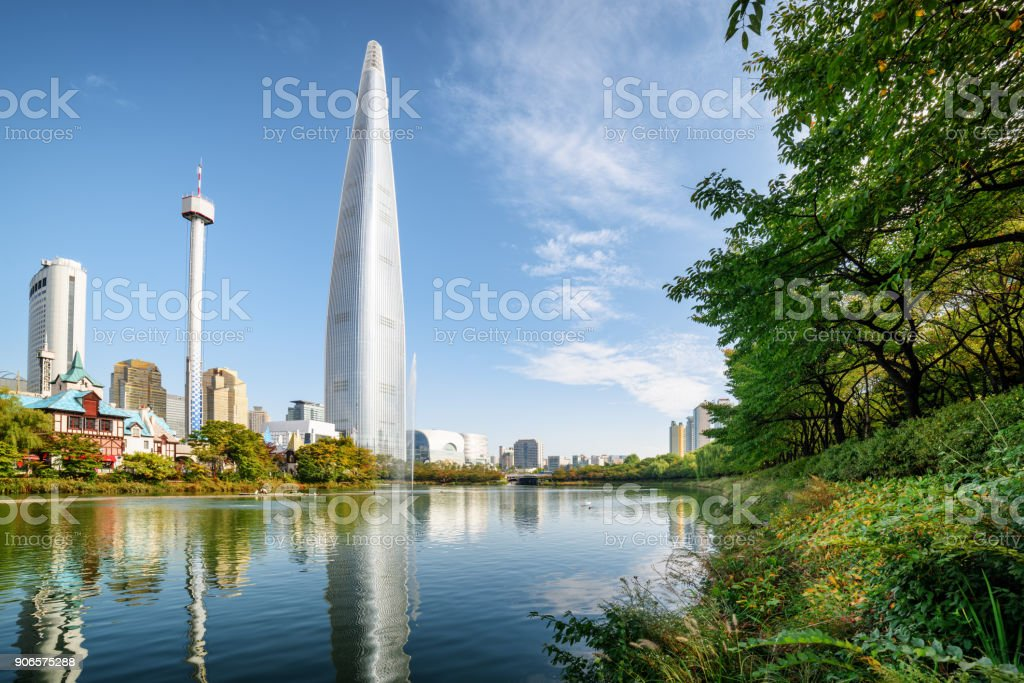 Lake among green trees in park at downtown of Seoul stock photo
