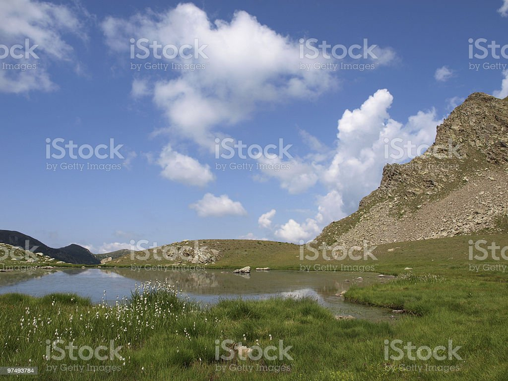 lake and blue sky in the French Alps royalty-free stock photo