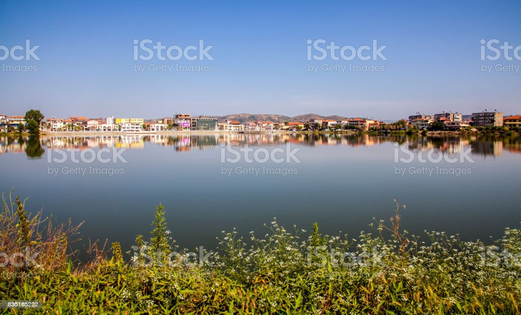 lake and city skyline in  the morning sunlight district Elbasan Albania stock photo