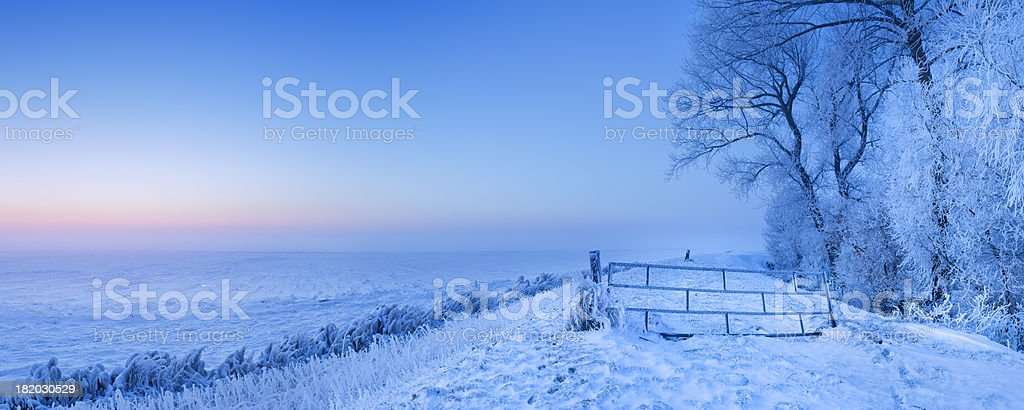 Lake and dike at dawn in winter in The Netherlands royalty-free stock photo