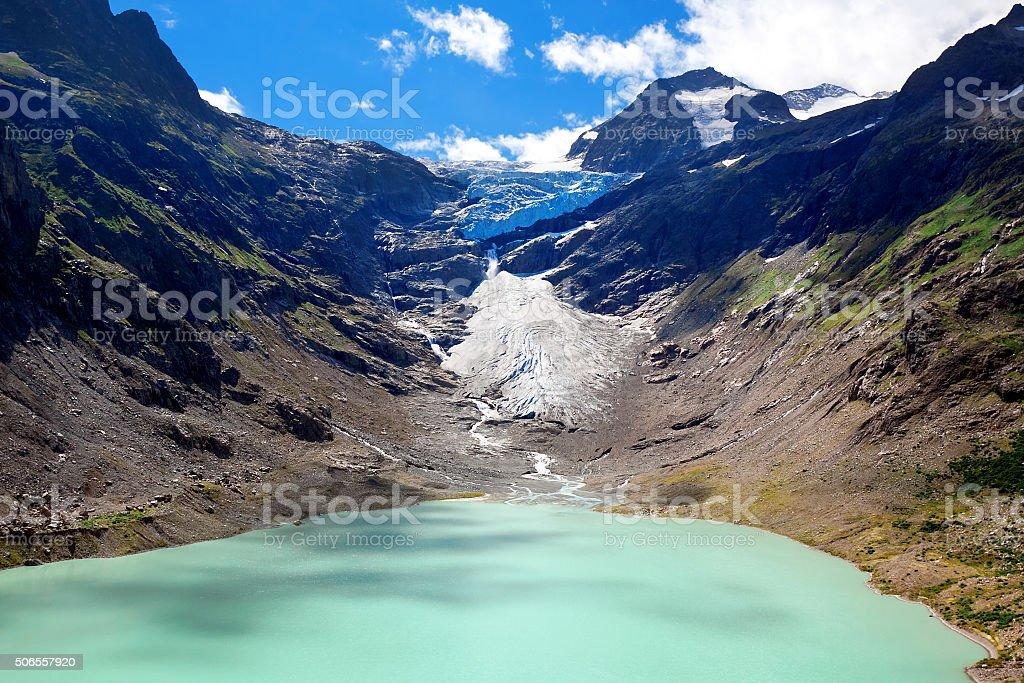 Lake and Glacier Trift in Alps stock photo