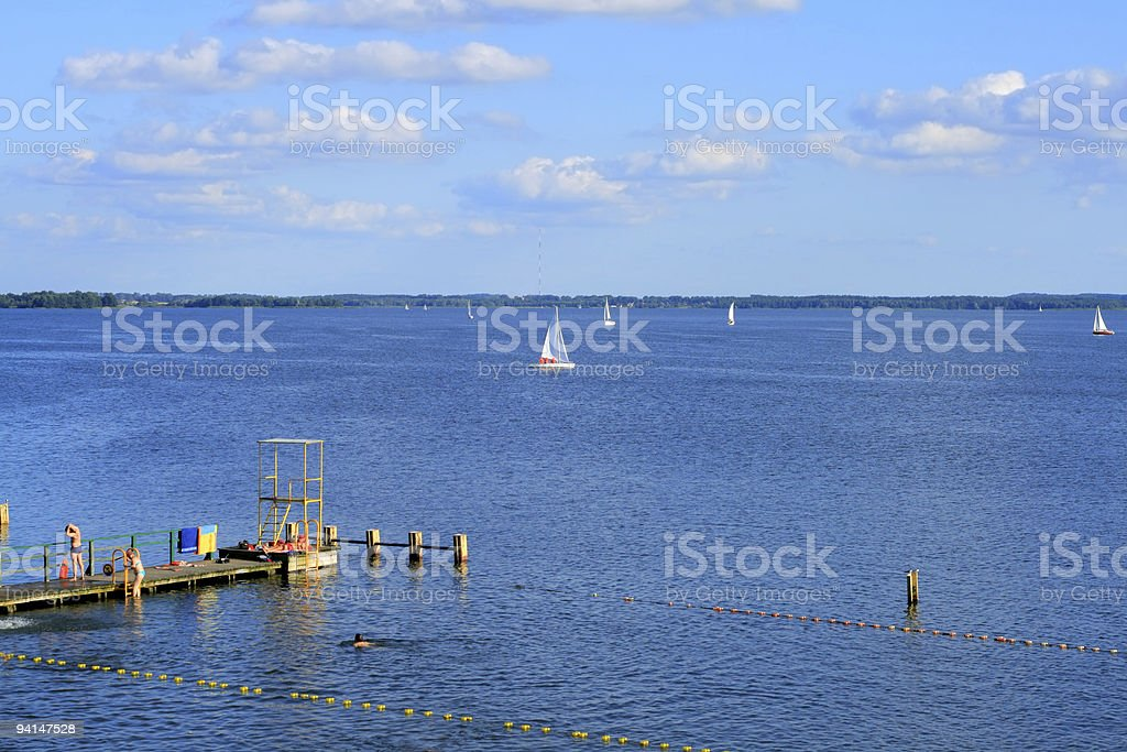 Lake and wooden pier stock photo