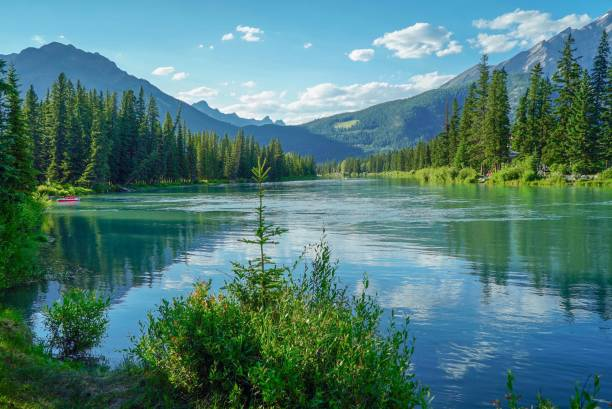 Lake at Bow River in Banff and Banff Indian Trading Post stock photo