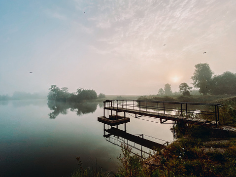 A lake at dawn in the mist near Barta, Latvia