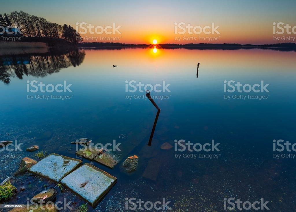 Lake at sunset. Boats mooring place. royalty-free stock photo