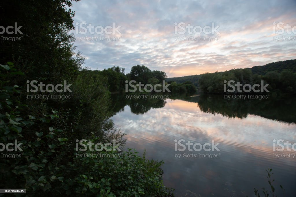 Lake at sunset with reflected clouds. stock photo
