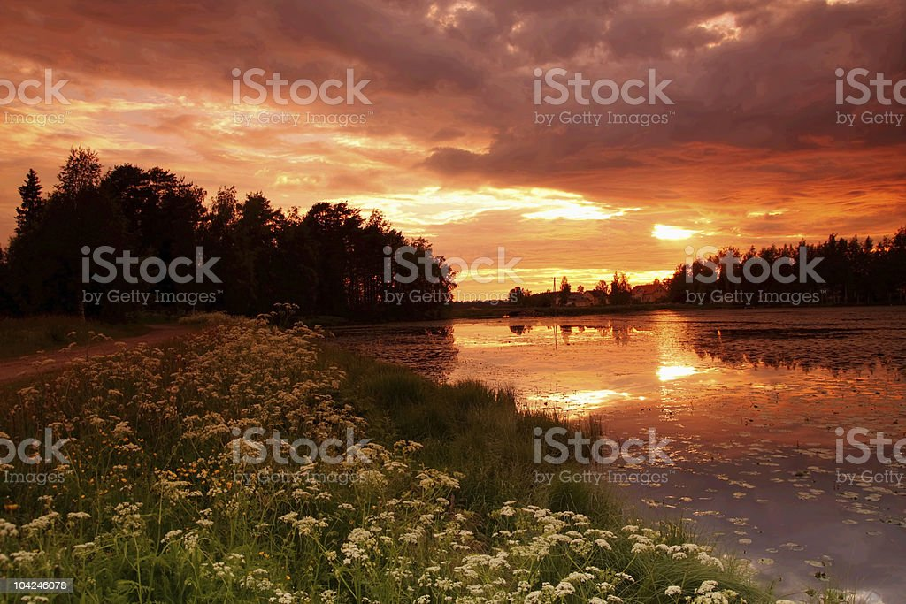 Lake at sunset with reflection in Finland royalty-free stock photo