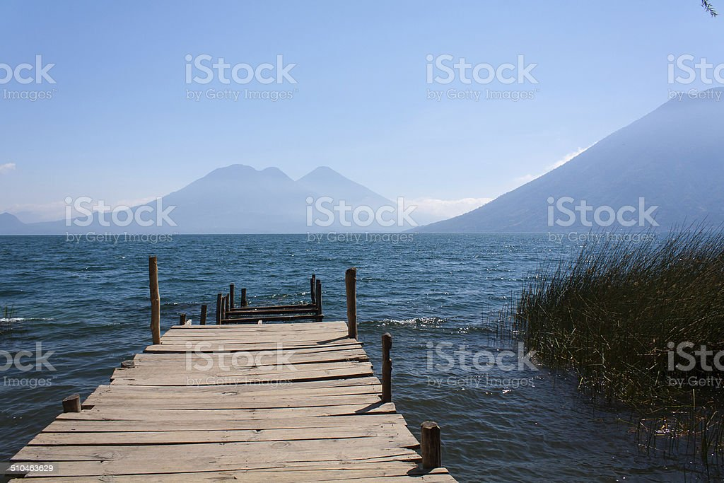 Lake Atitlan wooden pathway near San Marcos La Laguna Guatemala stock photo
