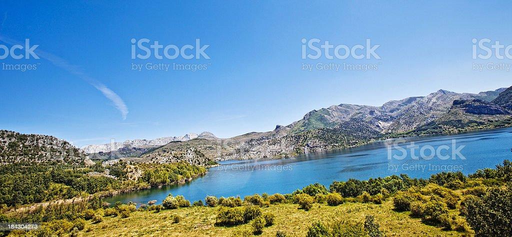 Lake between mountains. stock photo