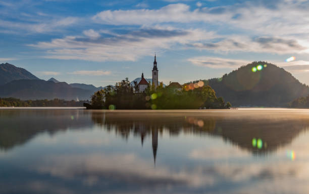 Lake Bled Lake Bled in the morning reflection lake stock pictures, royalty-free photos & images