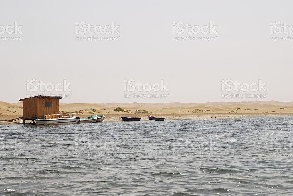 lake, boat and desert royalty-free stock photo