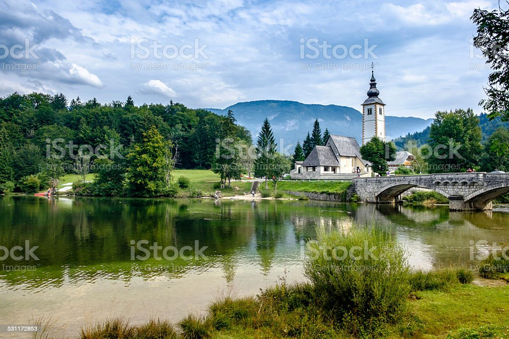 Lake Bohinj and the church in Ribčev Laz, Slovenia stock photo