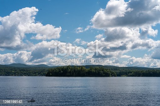Tranquil lake Bomoseen colorful landscape with summer clouds