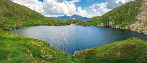lake capra of romanian fagaras massif panorama stock photo