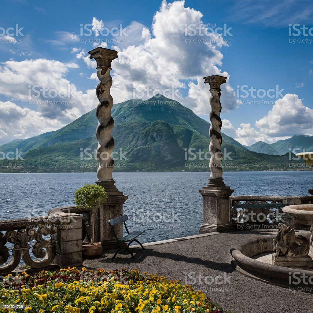 Lake Como and Mountains from shores of Varenna stock photo