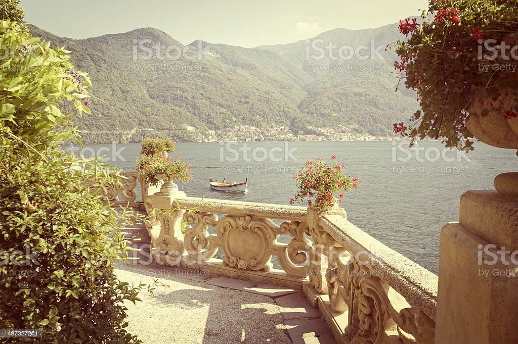 Lake Como, old stone balcony, lake mountain view, retro look stock photo