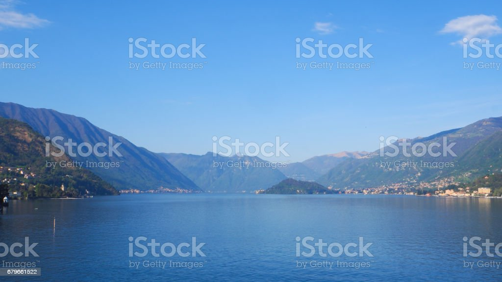 Lake Como panoramic view with blue sky background stock photo