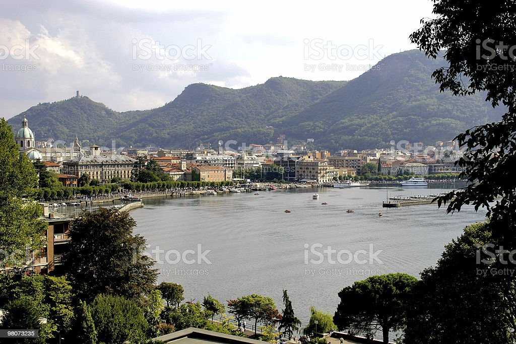 Lake Como with the city around and mountains in the horizon royalty-free stock photo