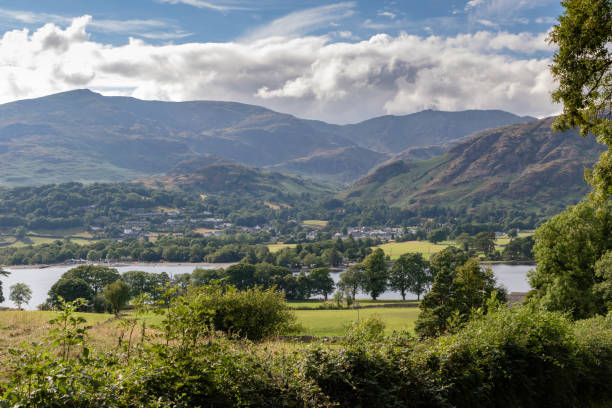 Lake Coniston Water and Coniston village in background in the Lake District National Park, UK Lake Coniston Water and Coniston village in background in the Lake District National Park, UK cumbria stock pictures, royalty-free photos & images