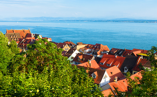 Lake Constance or Bodensee view from Meersburg city, Baden-Wurttemberg, Germany, Europe. Scenic landscape with old German town. Scenery of houses with red tile roofs in summer. Travel concept.