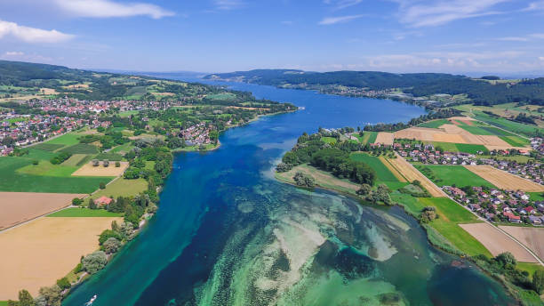 Lake Constance passes into the Rhine Eschenz, Switzerland - June 5, 2017: Here Lake Constance merges into the Rhine. This is the border area between Switzerland and Germany. Bodensee stock pictures, royalty-free photos & images