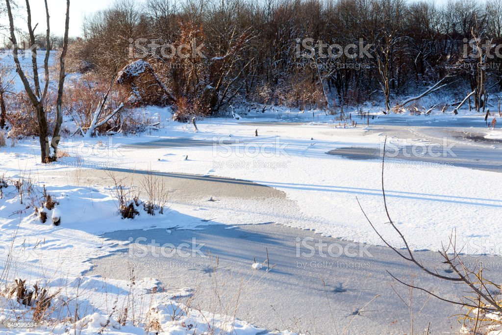 Lake covered with snow stock photo