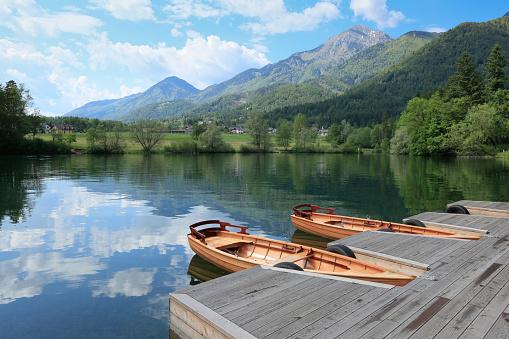 Breathtaking view of lake Crnava and Karavanke mountains in Preddvor, Slovenia