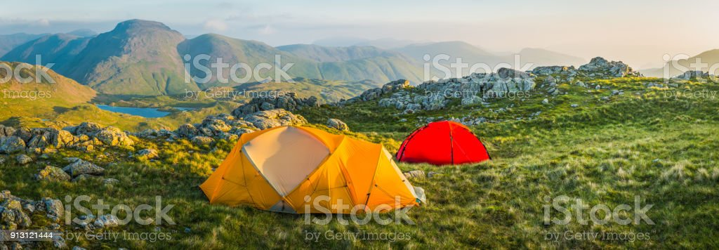 Lake District daybreak wild camping tents mountain fells panorama Cumbria stock photo