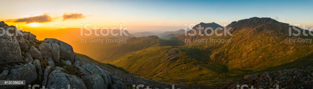 Lake District golden sunrise Bow Fell Langdales mountain peaks panorama stock photo