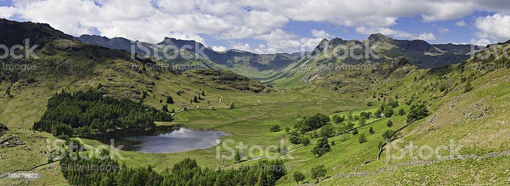 Lake District idyllic mountain valley vista summer peaks panorama stock photo