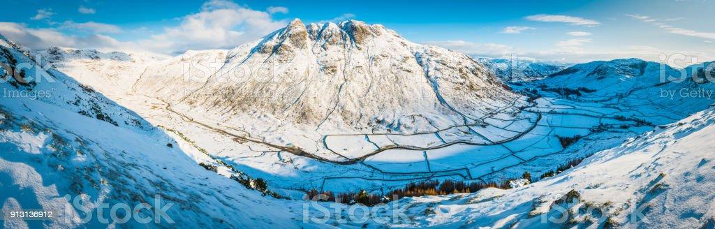 Lake District Langdale Pikes mountain peaks winter snow panorama Cumbria stock photo