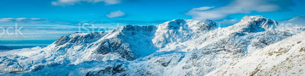 Lake District Scafell Pike snowy mountain summit winter panorama Cumbria stock photo