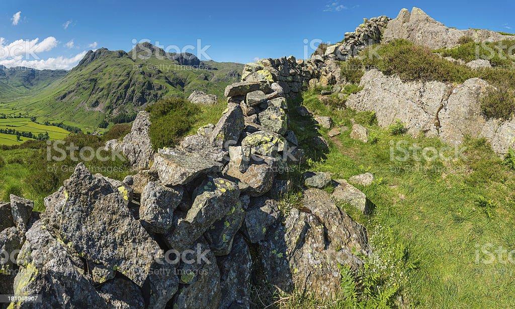 Lake District traditional dry stone wall idyllic mountain landscape Cumbria royalty-free stock photo