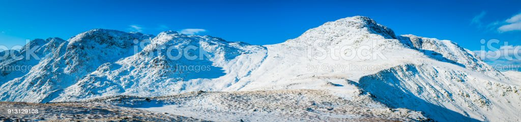 Lake District winter snow Crinkle Crags Bow Fell mountains panorama stock photo