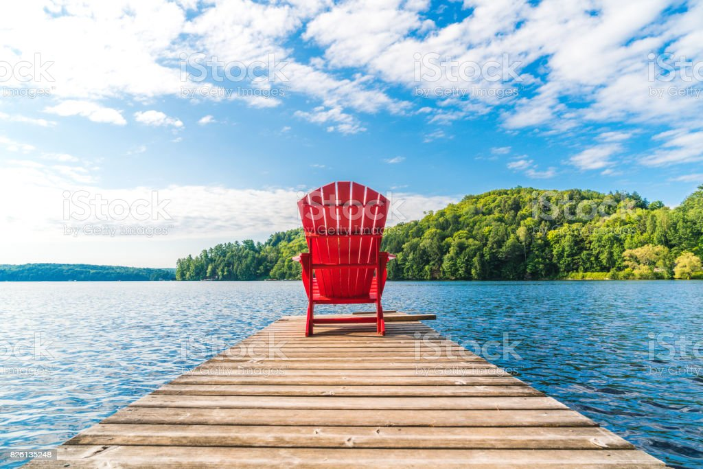 Lake Dock with Adirondack Chair stock photo