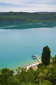 Boats and small marina on lake Gorges du Verdon, Saint Croix. River and lake located in Provence Alps Cote Azur, France.