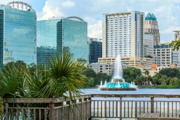 lake eola fountain with orlando's skyline - orlando florida photos stock photos and pictures