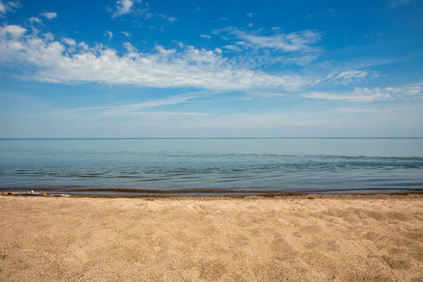 Lake Erie Beach Front The sandy beach of Lake Erie in Presque Isle State Park. sdominick stock pictures, royalty-free photos & images