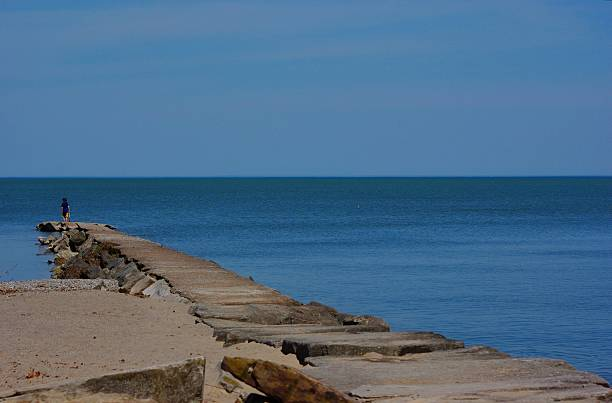 Lake Erie walkway Lake Erie at Huntington Reservation walkway, break wall on a calm day. groyne stock pictures, royalty-free photos & images