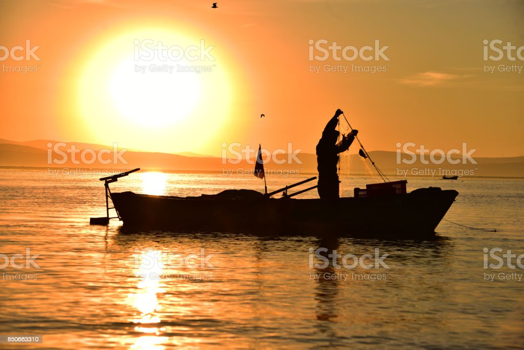 Lake fisherman and overtime work stock photo