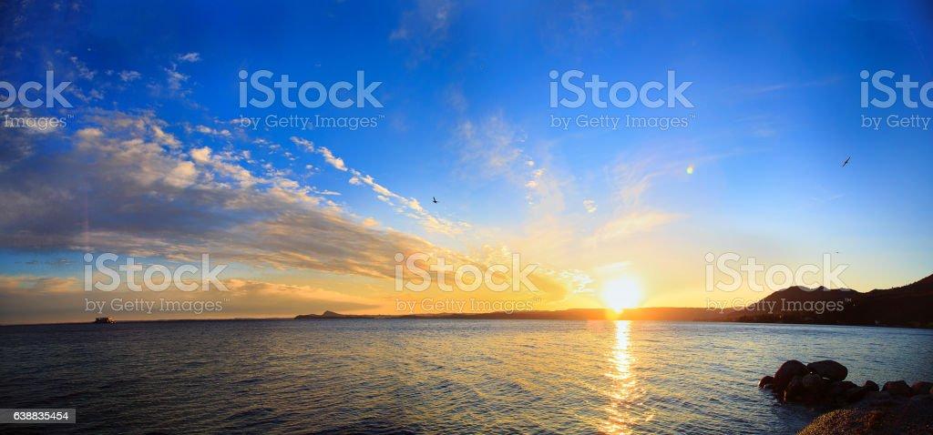 Lake Garda , Toscolano-Maderno, Italy.  Panoramic on sunset. - foto stock