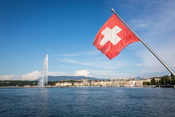 lake geneva and jet d'eau water fountain, switzerland - lake geneva stock photos and pictures