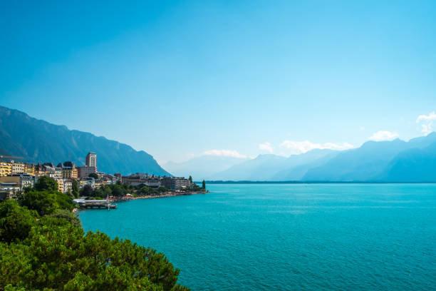 lake geneva and swiss mountains - lake geneva stock photos and pictures
