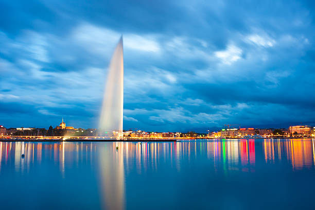lake geneva jet d'eau and sunset of alps - lake geneva stock photos and pictures
