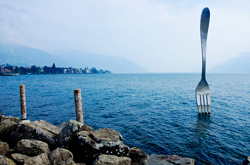 Lake Geneva shore with The Fork of Vevey modern installation art.