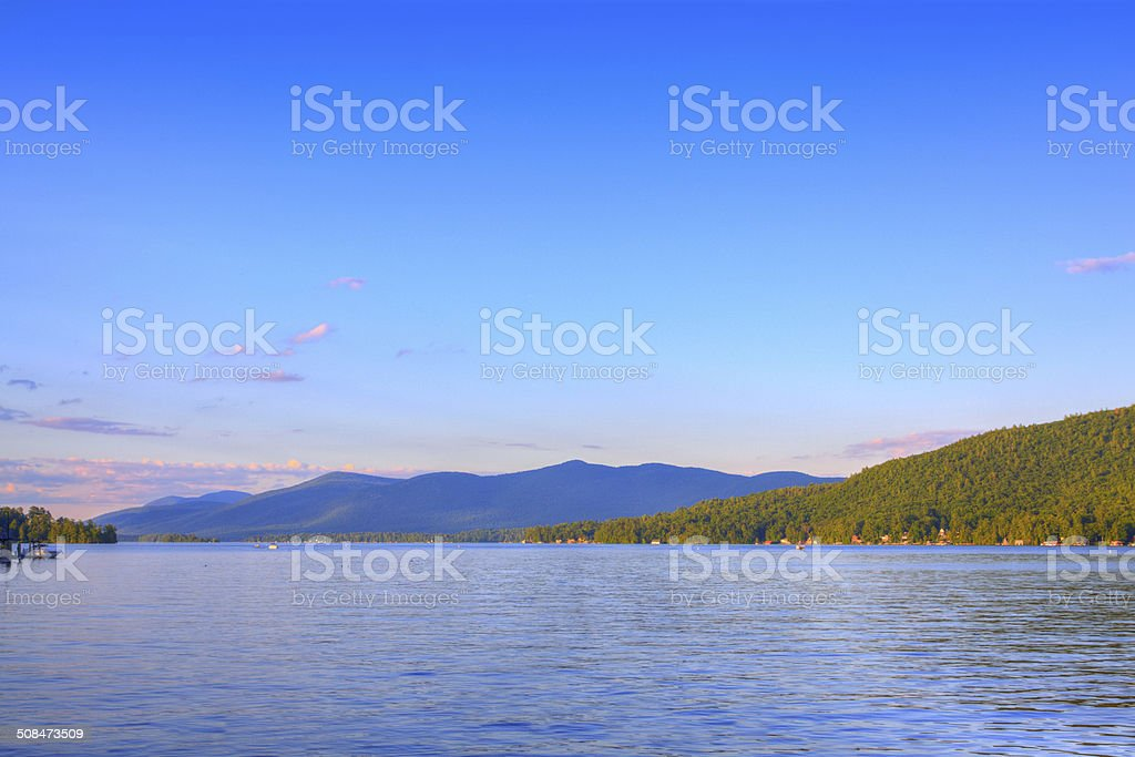 Lake George lit by evening sun, NY. stock photo