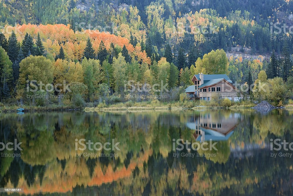 Lake House and Autumn Reflections stock photo