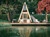 Lake side wooden triangle house